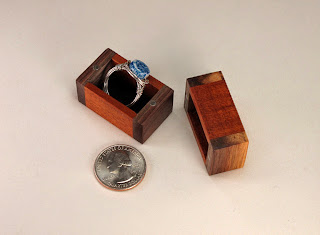 Closeup of a tiny jewelry gift box using acacia and walnut wood