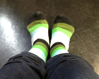 Greyson Chance black and green striped socks