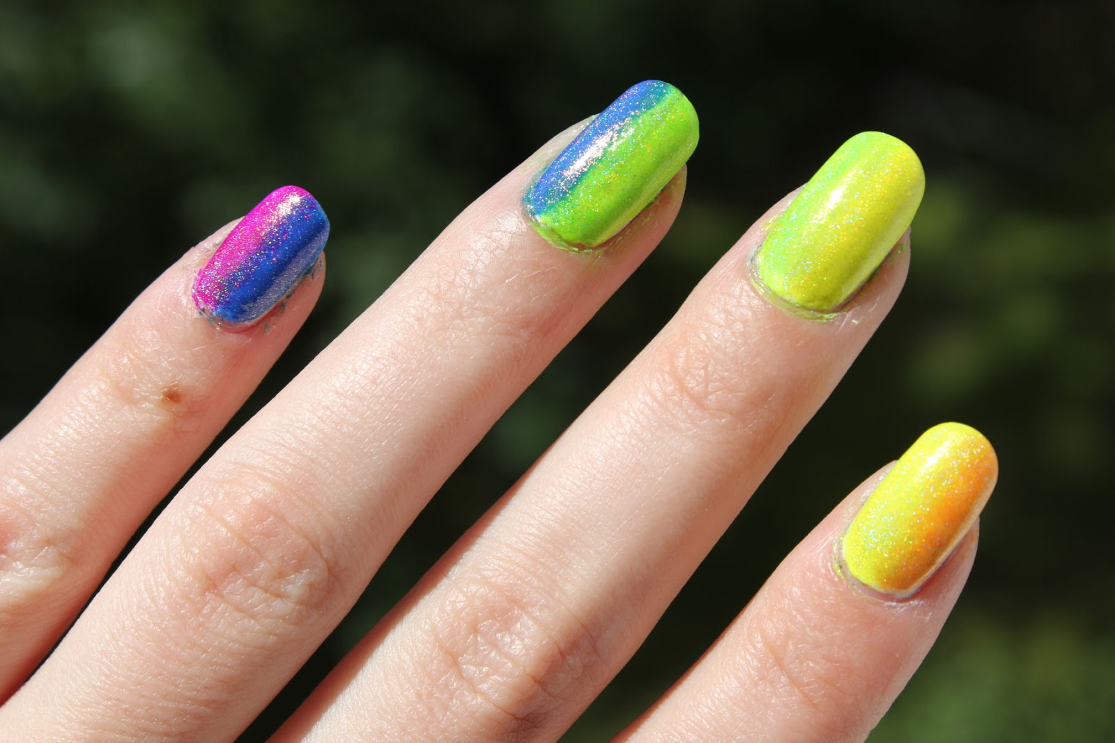 http://lacquediction.blogspot.de/2014/07/notd-rainbownails.html