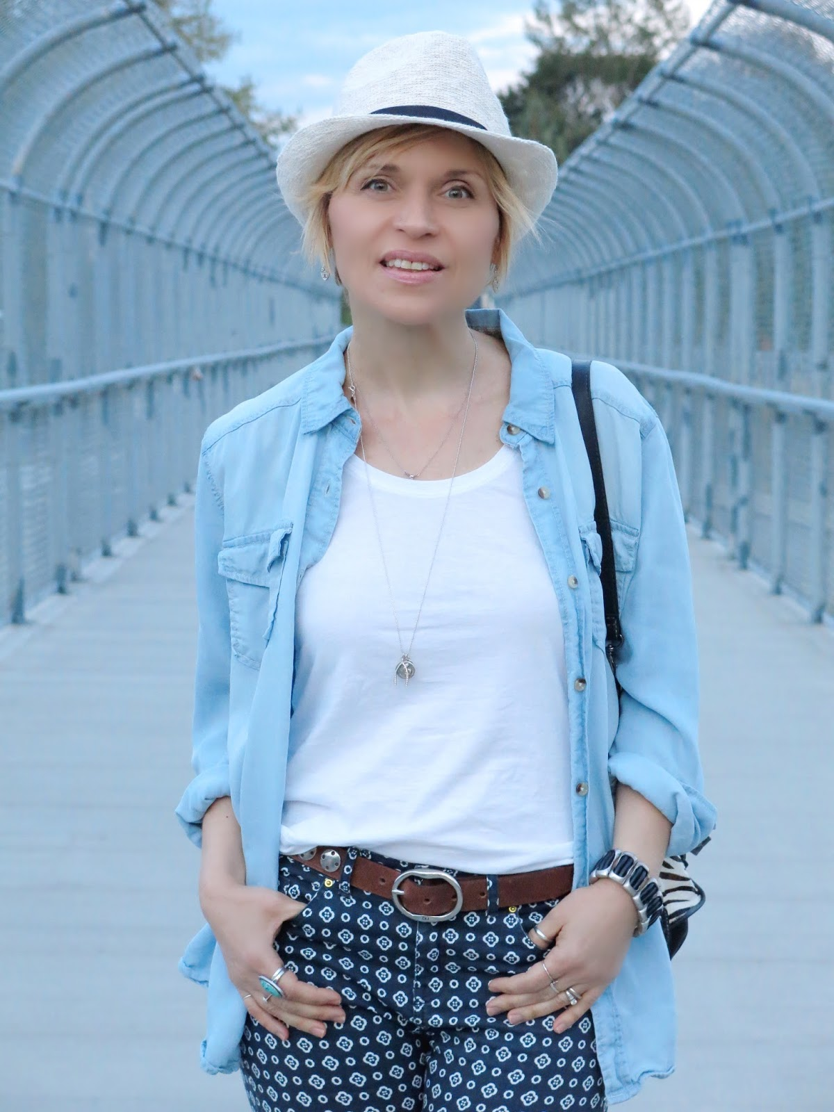printed pants, chambray shirt, and a summer fedora