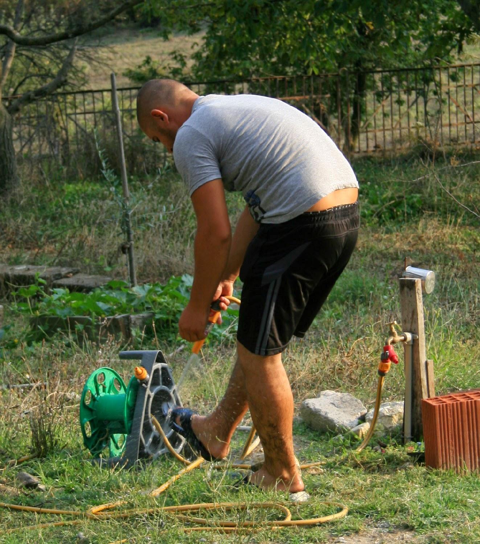Orhan washing his feet