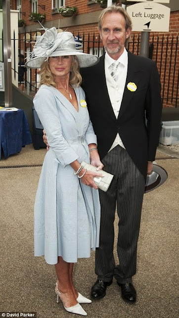 Genesis guitarist Mike Rutherford and his wife in pale blue outfit on day one of Royal Ascot, 2013