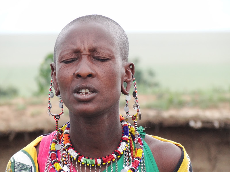 Maasai woman with stretched earlobes title=
