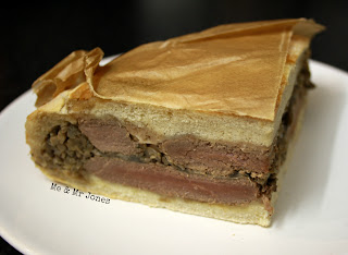 Shooter's Sandwich - a pressed samdwich filled with steaks and mushrooms