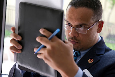 Keith Ellison studying notes on his iPad