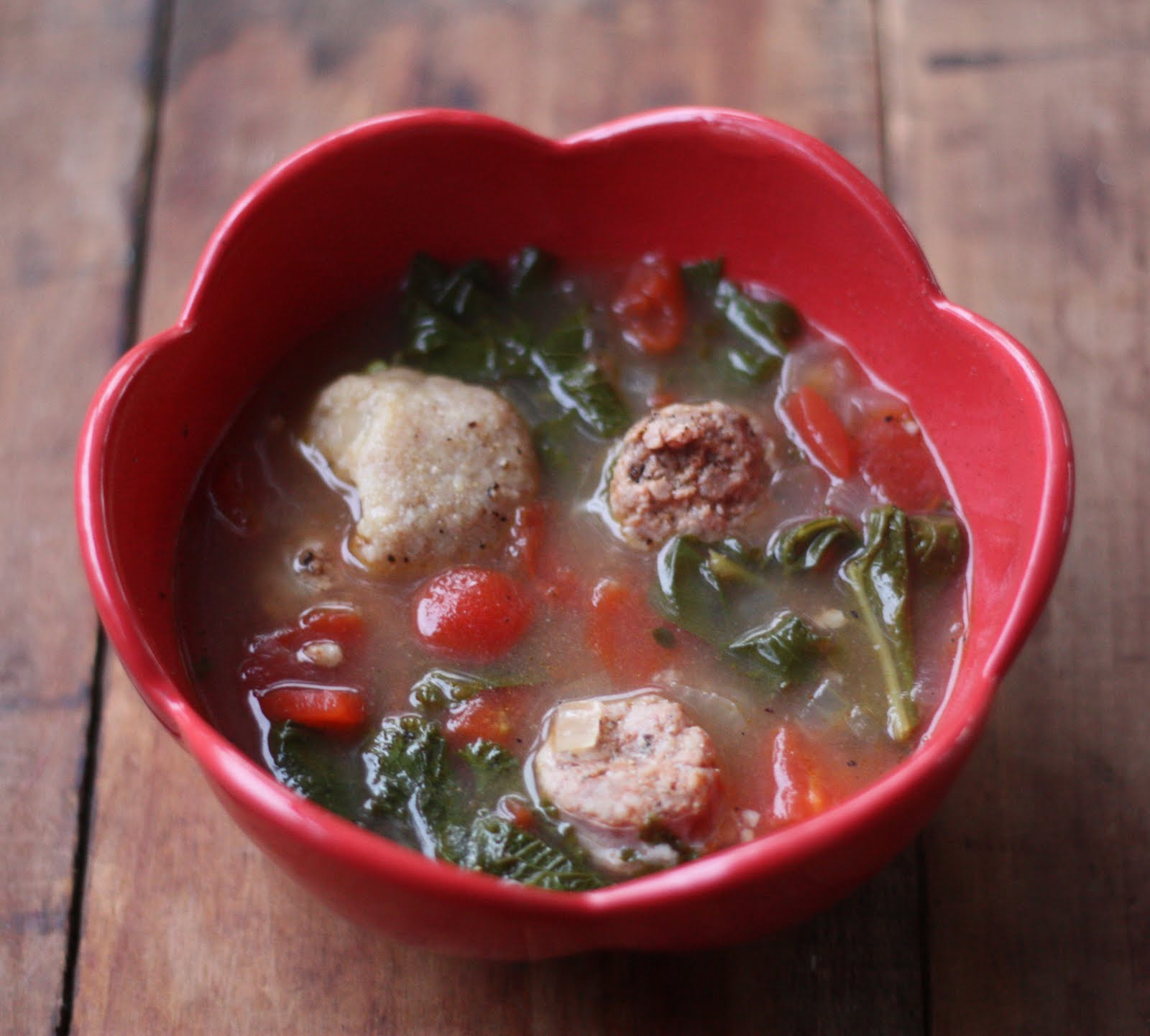 Mixed Greens and Sausage Soup with Cornmeal Dumplings
