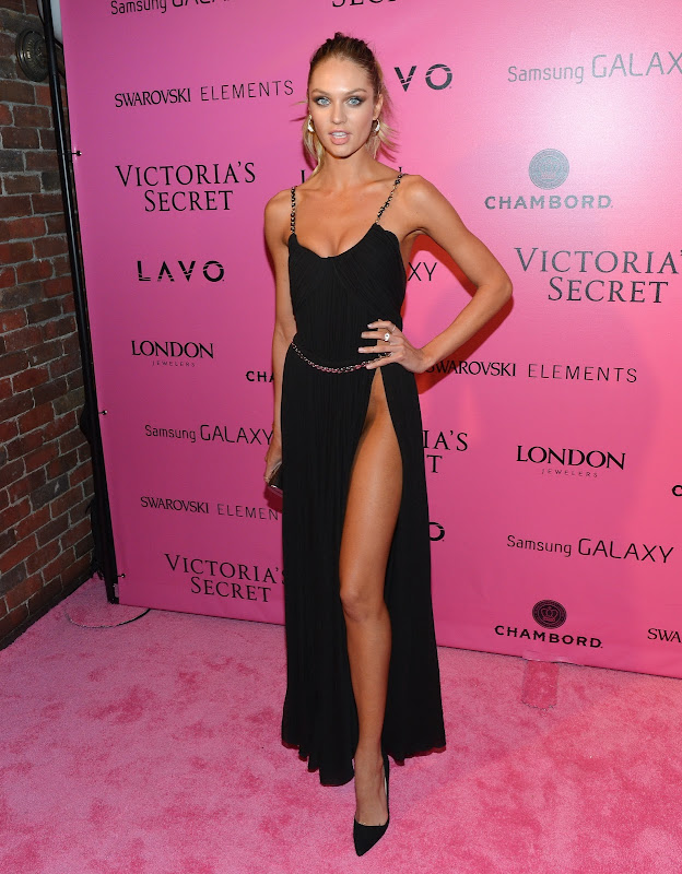Candice Swanepoel in a hot black dress on the pink carpet