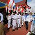 Zaki Membawa Bendera Saat Karnaval 2014