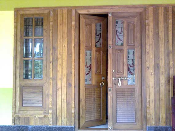Kerala house main door and french window design joy for House main double door designs