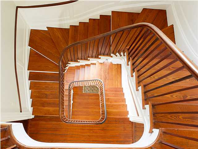 Wooden staircase as seen from the top floor looking down