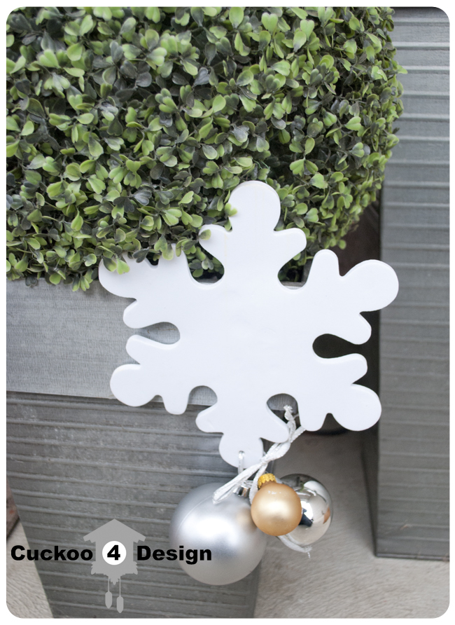 boxwood globes with white snowflake and Christmas ornaments