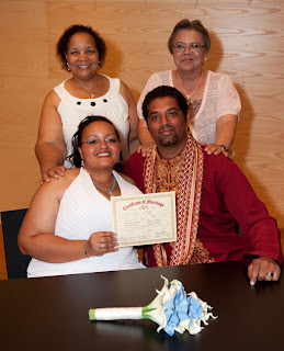 Tameka, Manoj and their mothers with the marriage certificate