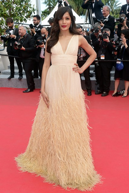 Freida Pinto in a beige custom-made Michael Kors tulle gown at Cannes 2014