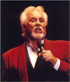 Microphone in hand, Kenny Rogers sings