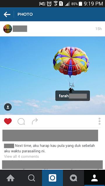 Adik went parasailing