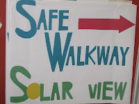 "Sign saying ""Safe Walkway Solar View"""