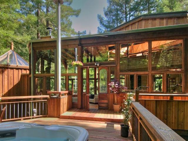 Photo of entrance into the tree house in the forest as seen from the terrace