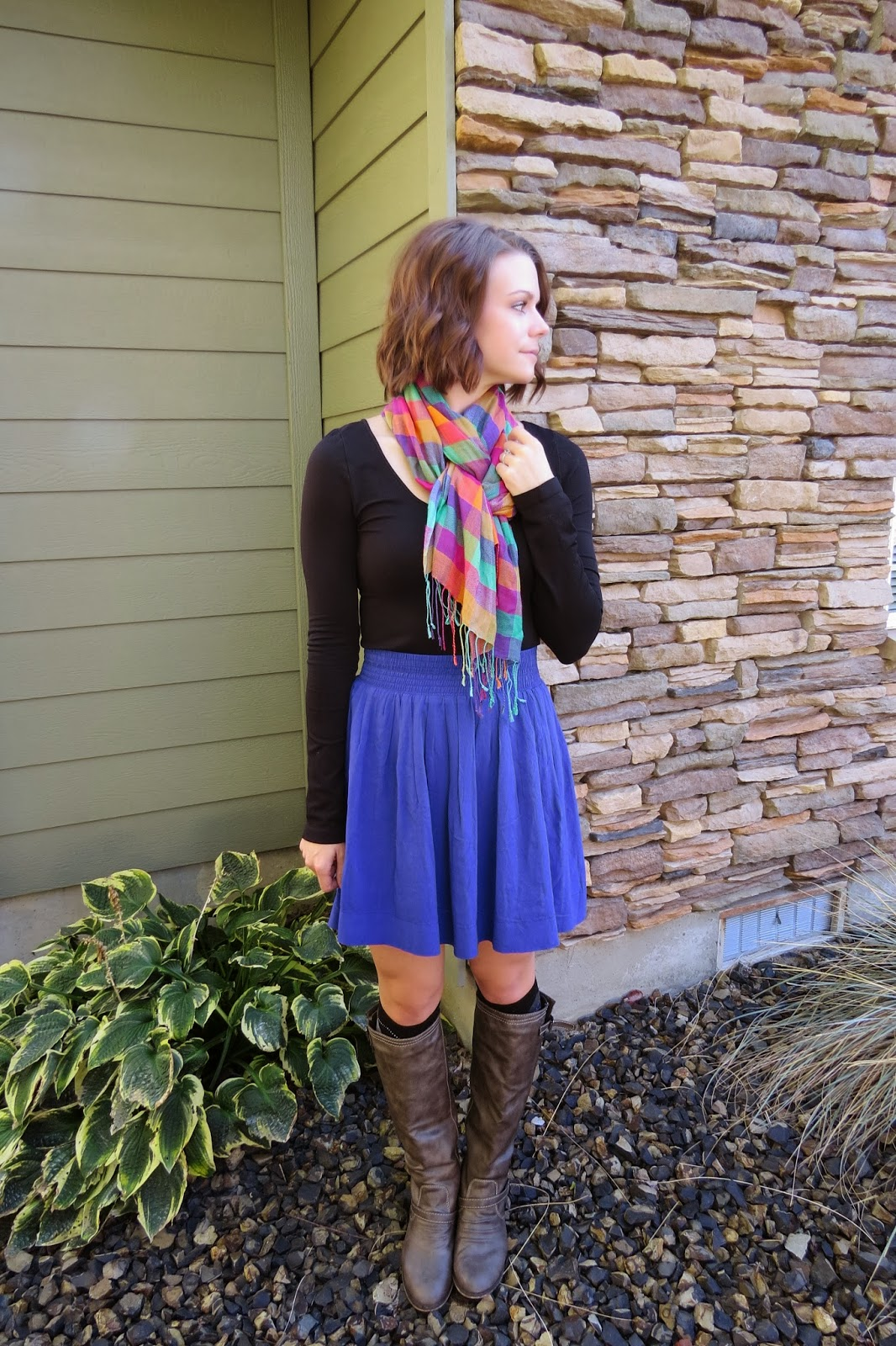 High-waisted skirt and boots, bright plain scarf and argyle knee socks