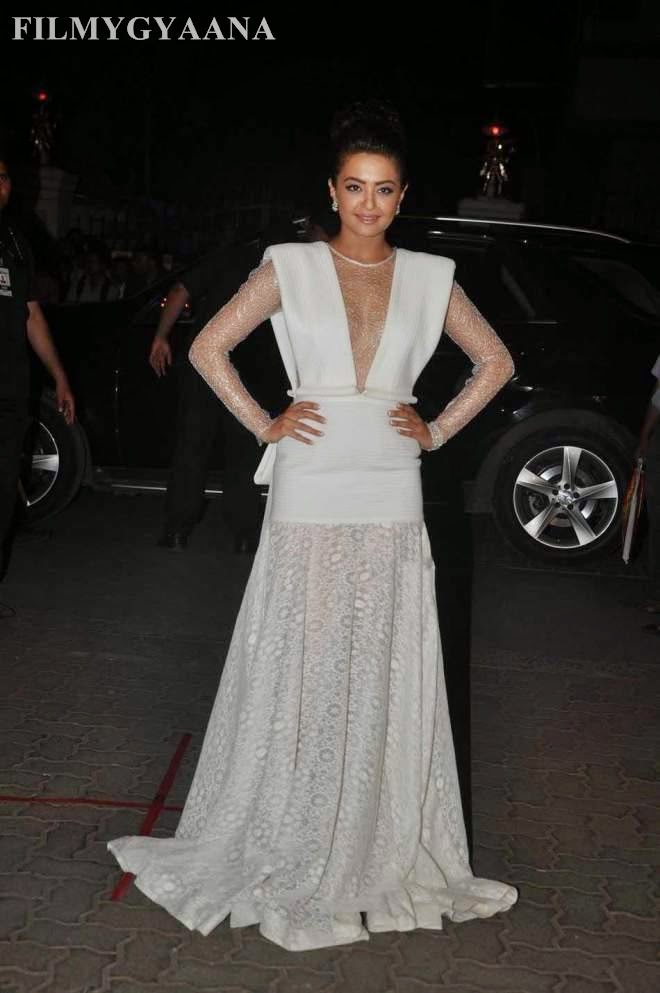 surveen chawla looks hot in white dress photos