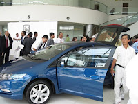 Guests surveying the Honda cars being displayed at the showroom