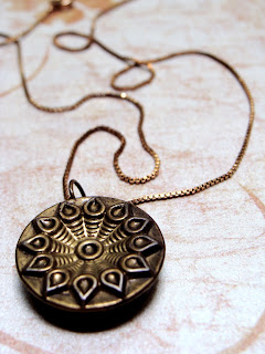 antique gold necklace pendant with solar flower design