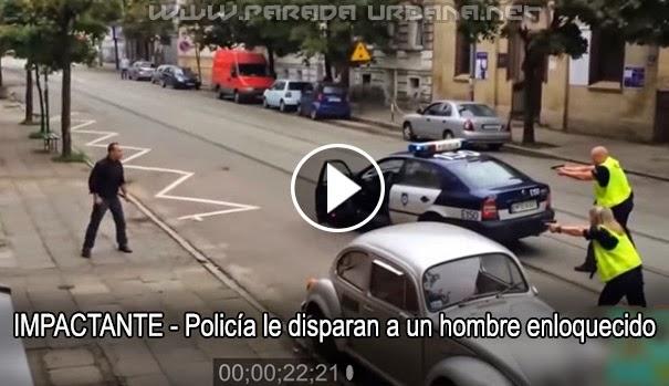 VIDEO IMPACTANTE - Policía le disparan a un hombre aparentemente enloquecido en plena calle