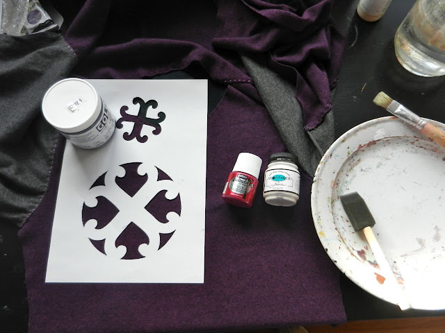Two stencils being painted onto fabric