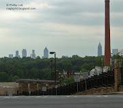 . Atlanta's posh Druid Hills neighborhood. Below: The skyline of Atlanta a .