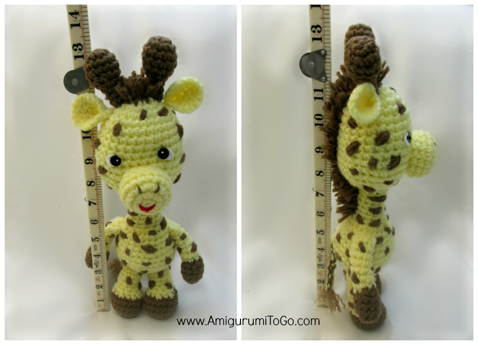 amigurumi giraffe standing next to ruler