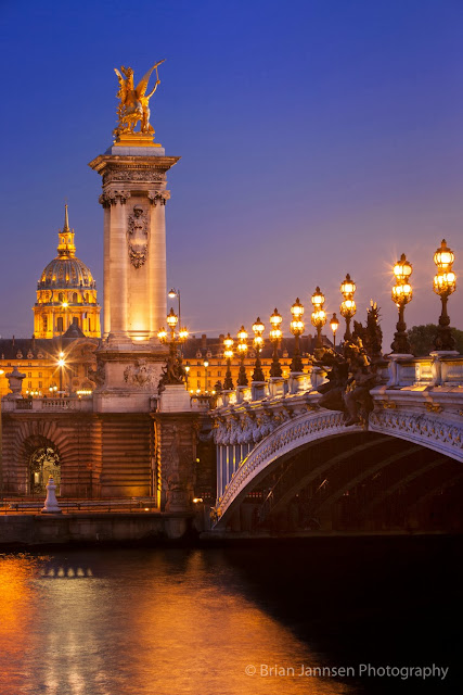 The Pont Alexandre III with the L'Hôtel national des Invalides or Les Invalides in the background.