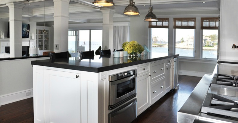 Beautiful coastal black and white traditional beachside kitchen with silver nautical lights