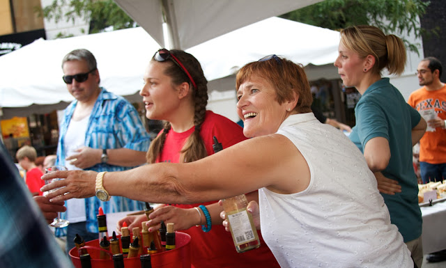 Taste of Downtown in Lansing, Michigan. Volunteers serve wine samples.