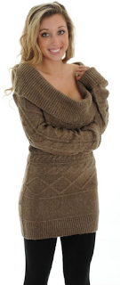 girl wearing a cowl neck brown sweater dress with leggings