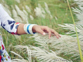 girl wearing bangles playing with flowers cover photo for facebook
