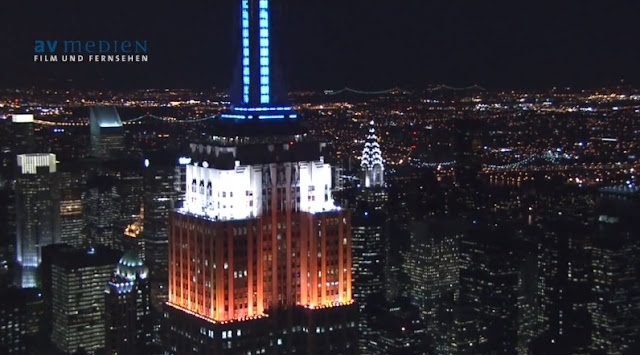Photo of top floors of Empire State Building at Night