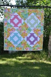 https://www.etsy.com/listing/219040158/pastel-brights-baby-quilt-pram-quilt