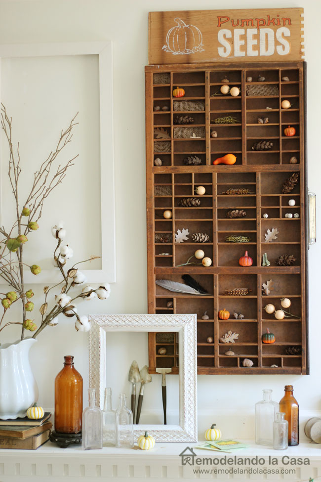 Mantel with cotton branches, little old bottles, leaves, fall, acorns