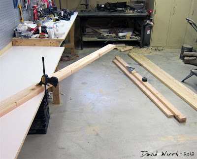 how to cut a 2x4, wood clamp, saw, measure, square, measuring tape