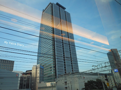 A tall skyscraper as viewed from the Shinkansen Nozomi Bullet train of japan