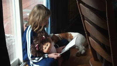 Image: Girl reading with dog