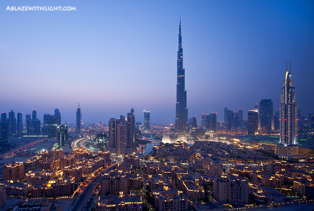 Photo of Burj Khalifa and other downtown lowrise buildings at sunset