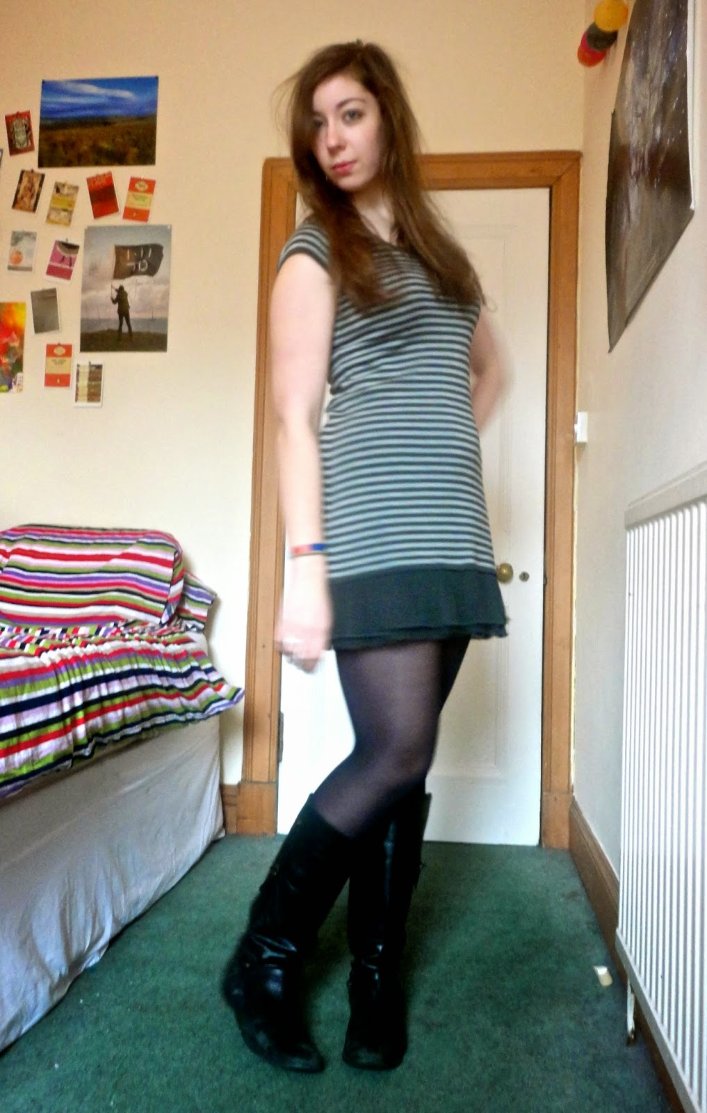 Outfit of grey striped dress with black tights and leather boots