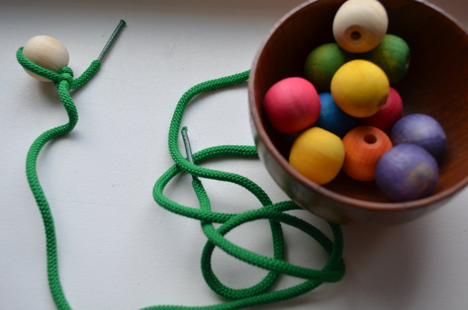 Rainbow Bead Stringing (Photo from The Education of Ours)