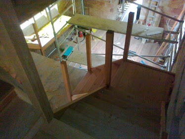 Standing on the top flight of stairs (Bluegum) looking down through 2 floors