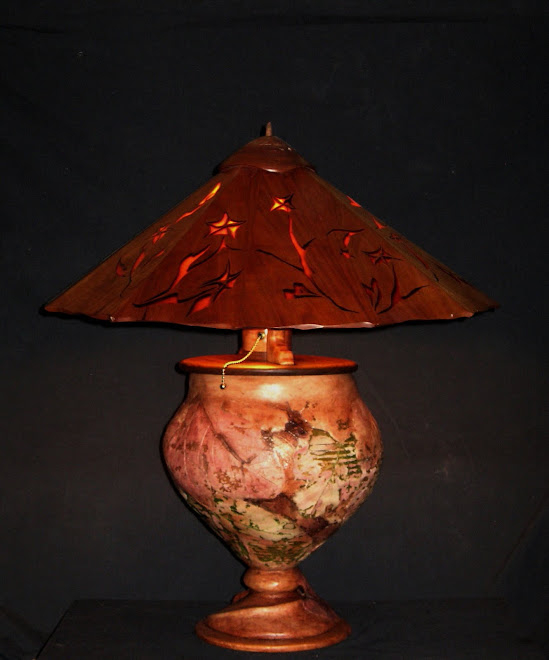 """Out of the Night"" lamp with cherry wood shade and eco dough base with various other woods"
