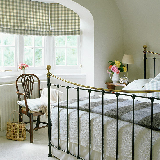 Bedroom with Antique Wrought Iron Bed