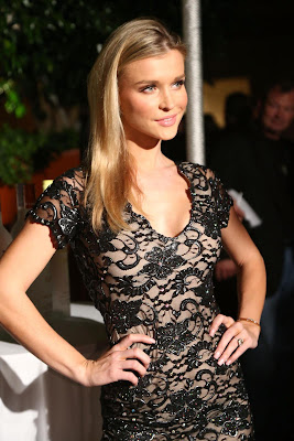 Joanna Krupa sexy cleavy and leggy wearing black lace open back dress at Voli Light Vodka's Holiday Party
