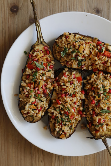A plate of aubergines stuffed with grains