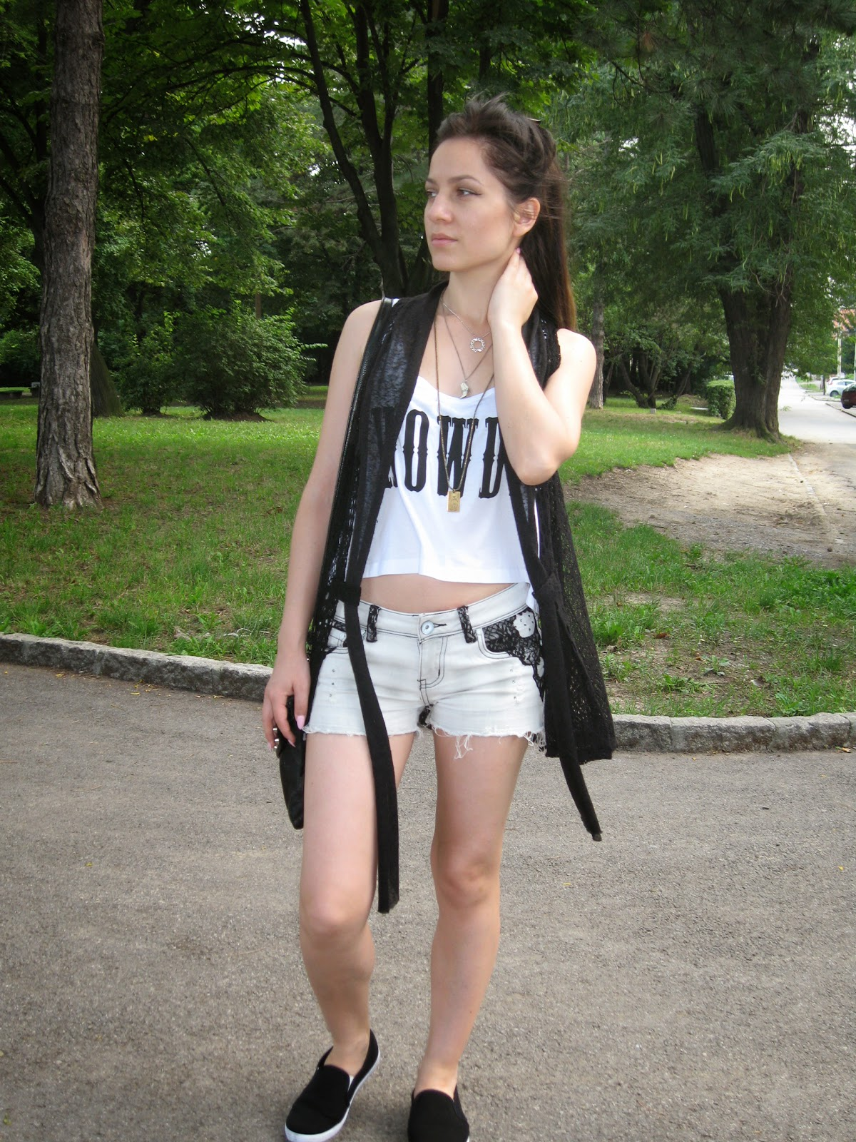 new yorker white crop top, white denim shorts with lace details, black slip ons, black crochet vest, layered gold silver necklaces, black studded clutch, casual look,