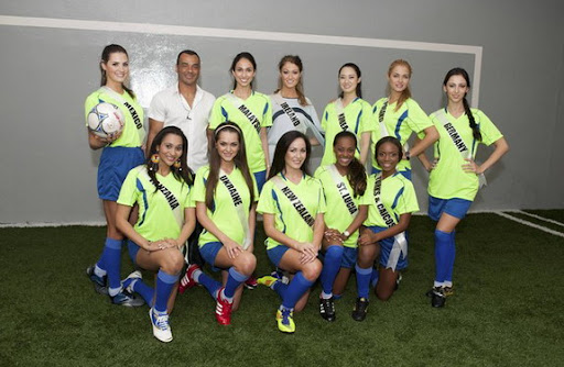 Former Brazil national team captain Cafu poses for a photo with Miss Universe 2011 contestants